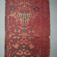 Textile fragment, part of a garment, lampas, silks and gilt paper wrapped thread